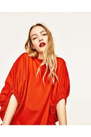 Zara VESTIDO GOMA MANGA - Disponible en más colores
