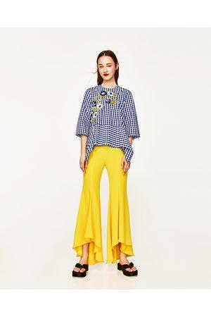 Mujer Pantalones y Leggings - Zara PANTALÓN FLARE ASIMÉTRICO - Disponible en más colores