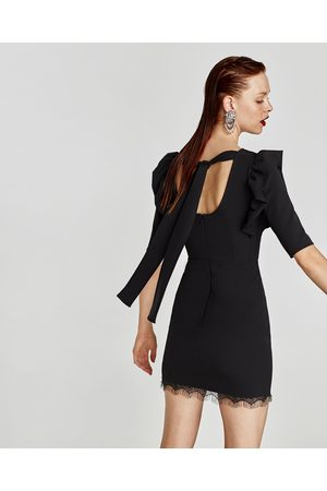 Vestido negro lazo espalda