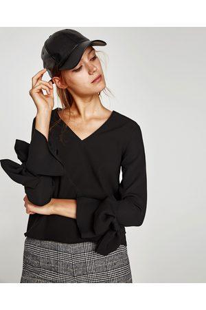 Zara BLUSA ESCOTE PICO MANGA LARGA - Disponible en más colores