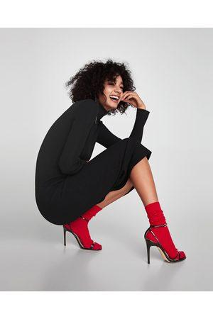 Vestido negro raya roja zara