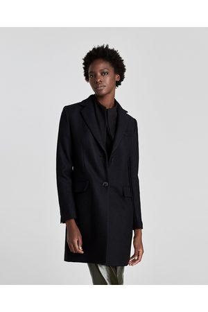 zara abrigo negro para hombre