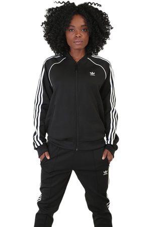 Chamarra lisa Adidas Originals negra