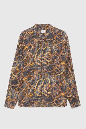 Zara Camisa estampado cadenas