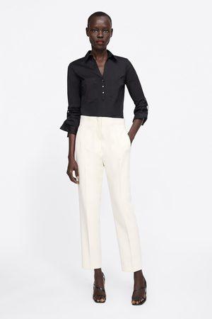Zara Camisa básica bolsillos
