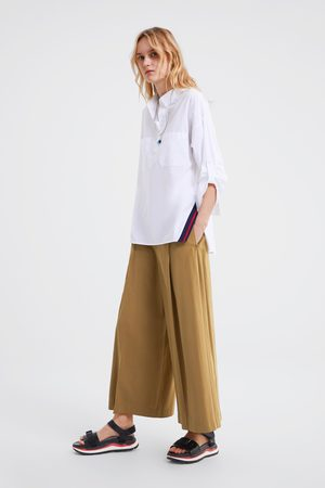 Zara Blusa oversize bolsillos