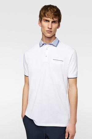 Zara Polo piqué cuello combinado