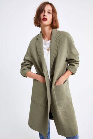 Zara Abrigo oversize bolsillos
