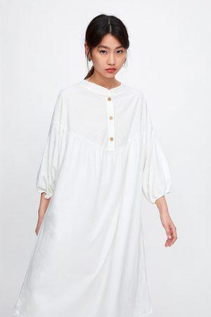 Zara Vestido blusón botones