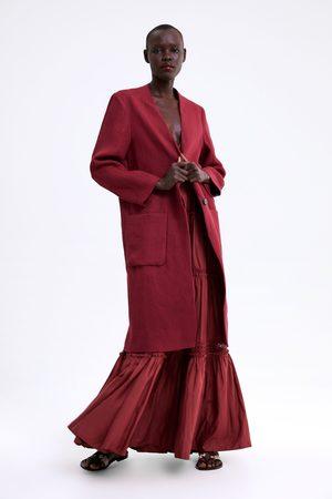 Zara Abrigo lino bolsillos