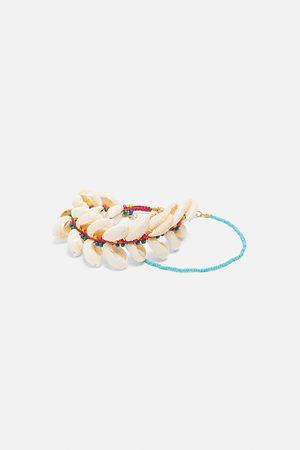 Zara Pack pulseras tobilleras conchas