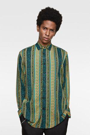 Zara Camisa estampación cadenas