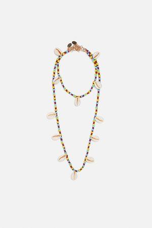 Zara Pack collar y pulsera tobillera conchas