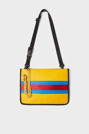 Zara Bandolera amarilla cadena