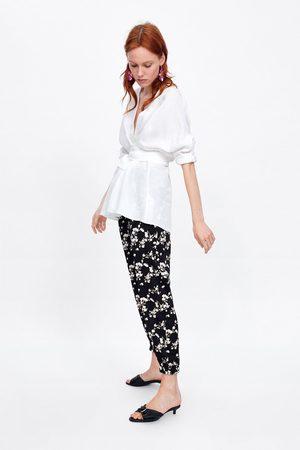 zara pantalones brillo traje estampado floral