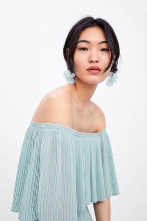 Zara Vestido plisado manga capa