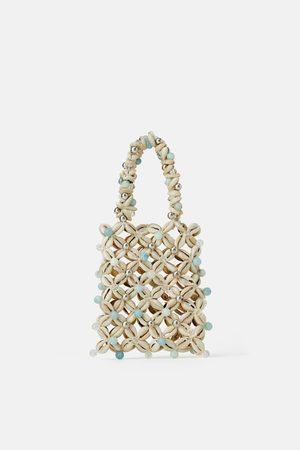 Zara Mini bolso de mano conchas