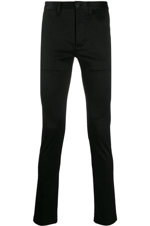 Saint Laurent Pantalones tipo chino ajustados