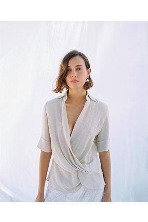 Zara Blusa rústica nudo