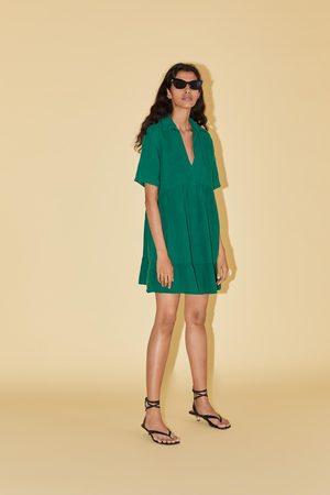 Zara Vestido mini costuras