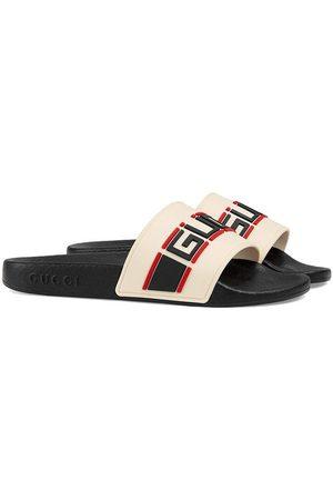 Gucci Flip flops con logo estampado