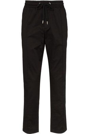 Dolce & Gabbana Pantalones de chándal con placa del logo