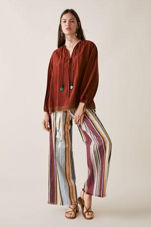 Zara Studio blusa cordón abalorios edición limitada