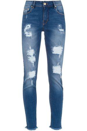 AMAPÔ Skinny jeans con detalles rasgados