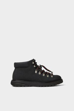 Zara Bota montaña negra tejido premium