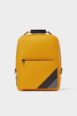 Zara Mochila rayas amarilla