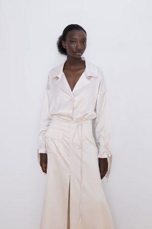 Zara Mujer Faldas - Falda satinada bolsillo