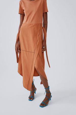 Zara Vestido midi costuras