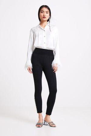 Zara Legging bajo corchetes