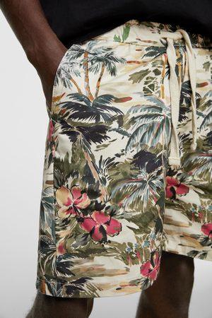 Zara Bermuda estampado tropical