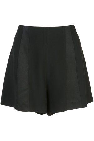 Kiki de Montparnasse Shorts de tiro alto