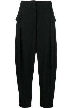 Stella McCartney Pantalones tapered con bolsillos con solapa
