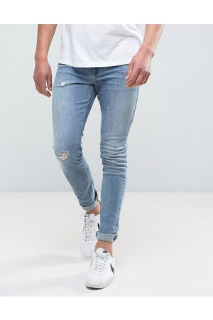 ASOS Super skinny jeans in mid wash blue with abrasions
