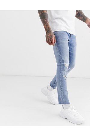 ASOS Cropped skinny jeans in light wash with raw hem and busted knee