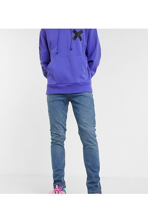COLLUSION X001 skinny jeans in blue mid wash