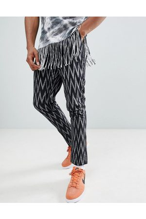 ASOS Festival tapered trousers in black aztec print