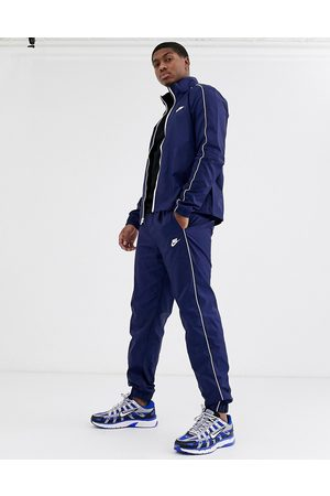 Nike Woven tracksuit in navy