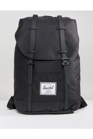 Herschel Retreat backpack in black with rubberised straps