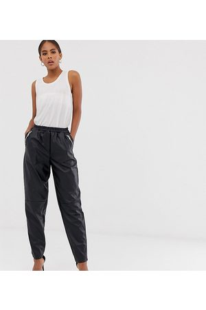 ASOS ASOS DESIGN Tall tapered leather look trousers