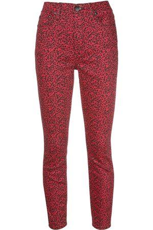 ALICE+OLIVIA Pantalones skinny con estampado de leopardo