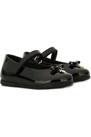 Dolce & Gabbana Flats con dije de corazón