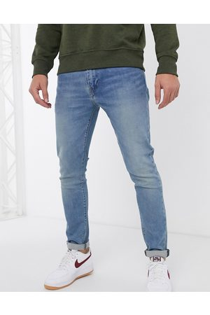 Levi's Hombre Skinny - 512 slim tapered fit jeans in pelican rust mid wash