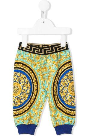 VERSACE Pantalones - Pants con diseño colour block y logo