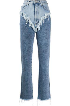 Natasha Zinko Jeans a capas con detalles rasgados