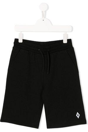 MARCELO BURLON Pantalones cortos de deporte elásticos
