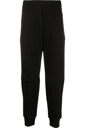 Alexander McQueen Hombre Pantalones y Leggings - Pants con parche del logo bordado